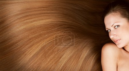 Fashion conceptual portrait of a woman with beautiful long healthy shiny hair