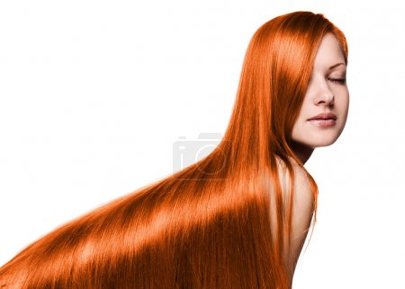 Photo for Portrait of a beautiful woman with long red healthy shiny straight hair, isolated on white - Royalty Free Image