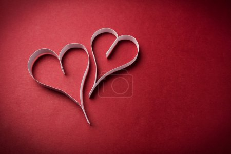 Photo for Two valentine's paper hearts on red - Royalty Free Image
