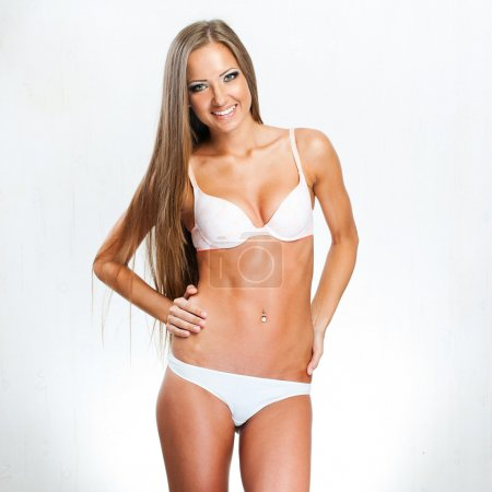 Beautiful young long-haired girl in white underwear