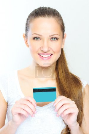 Business woman holding credit card