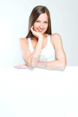 Woman holding big blank paper