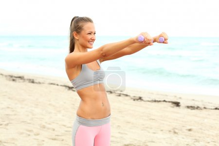 Fitness instructor making exercise
