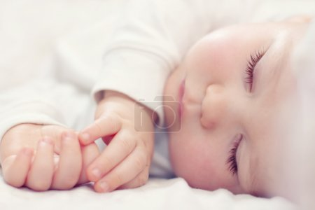 Close-up portrait of a beautiful sleeping baby on ...