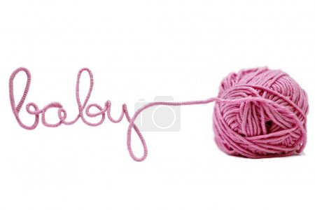 Pink baby word made of yarn isolated on white