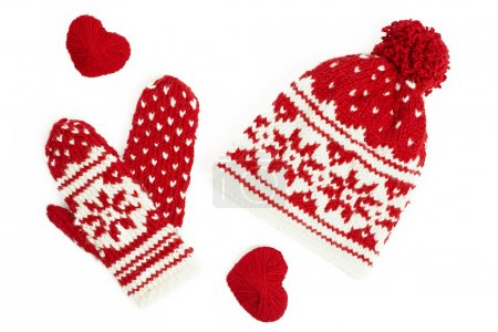 Photo for Winter cap and mittens knitted with jackard and heart motifs. on white - Royalty Free Image