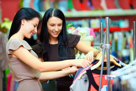 Photo for Two smiling woman shopping in retail store - Royalty Free Image