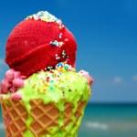 Tasty melting ice cream on summer background...