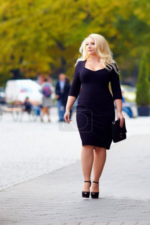 attractive overweight woman walking the city street