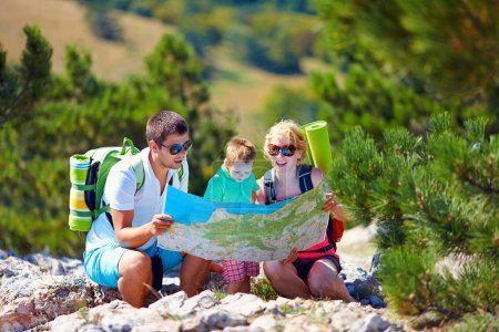 Photo for Family in mountains discussing the route - Royalty Free Image