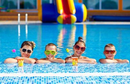 Group of happy teenage kids in the pool...