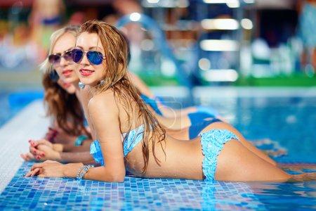 seductive girls enjoy summer in pool