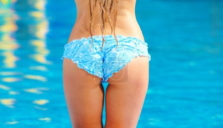 rear view of sexy girl near the pool