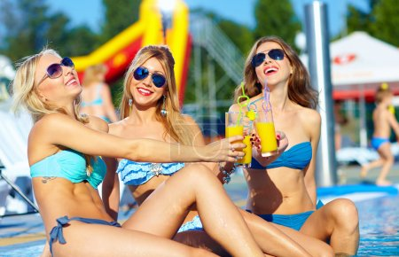 Photo for Happy female friends enjoying summer near the pool - Royalty Free Image