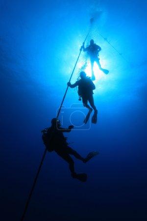 Scuba divers on decmpression stop
