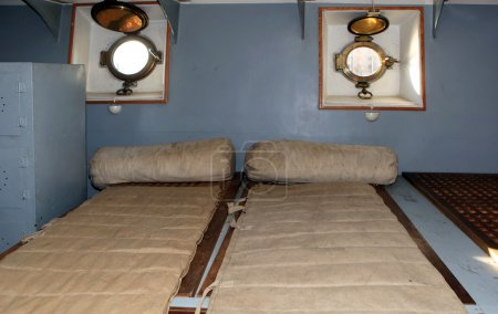 Berths in the forecastle aboard the cruiser