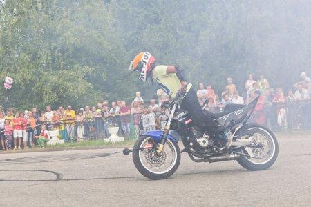 Lots of smoke on Moto show in Verkhovazhye, Vologda region, Russia. Foma Kalinin young stunt