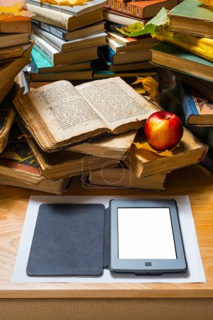 Photo for Ebook and old books on table - Royalty Free Image