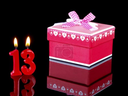 Birthday-anniversary gift with red candles showing Nr. 13