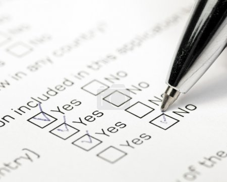 Photo for Close up shot of filled check boxes with pen - Royalty Free Image