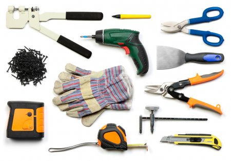 Photo for Plasterboard tools set with punch lock crimper, marker pen, tin snip cutter, screws, screw gun, plaster spreader, protective gloves, laser level, tape measure and ci - Royalty Free Image