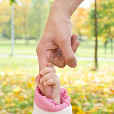 Father holding a baby hand