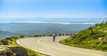 Female mountain bike cyclist riding