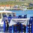 A view of a typical Greek restaurant at the town o...