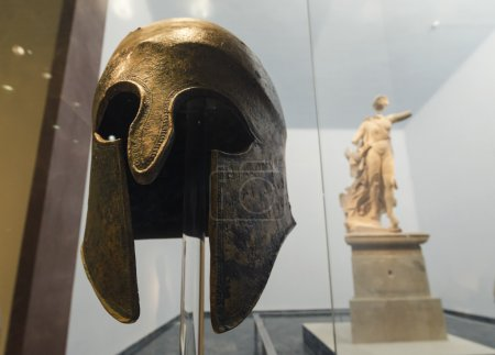A close up of an original ancient greek helmet and...