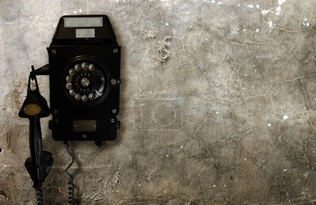 Old Telephone on Concrete Wall