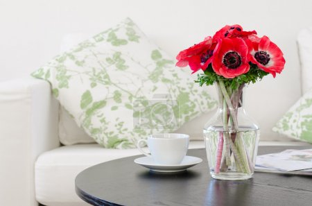 Photo for Vase of red flowers in modern white living room - home decor - Royalty Free Image