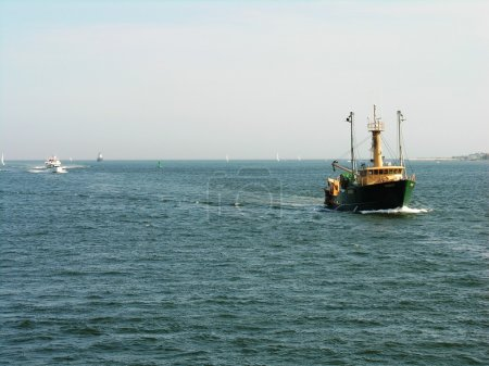 A Fishing boat approaching the harbor