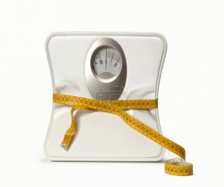 Photo for Weight scale with a measuring tape. - Royalty Free Image