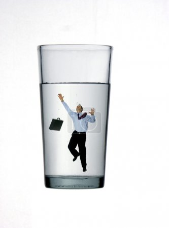 One businessman inside a glass on white background.