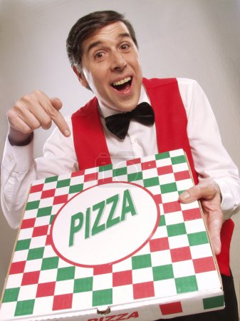 Pizza delivery man pointing at the pizza box