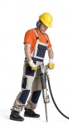 Photo pour Ouvrier de forage sur fond blanc. - image libre de droit