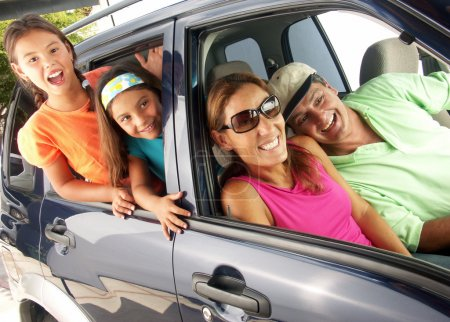 Hispanic family in a car. Family tour in a car.