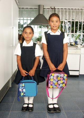 Two little sisters going to school.