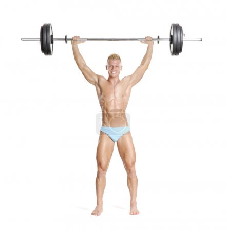 Photo for Young and strong man holding a barbell. - Royalty Free Image