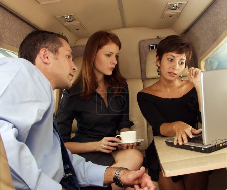 Business working at private jet