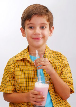 Photo for Little boy drinking strawberry milkshake - Royalty Free Image