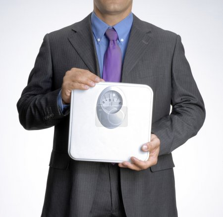 Businessman holding weights