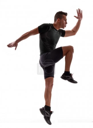 Fitness young man training and doing aerobic exercise.