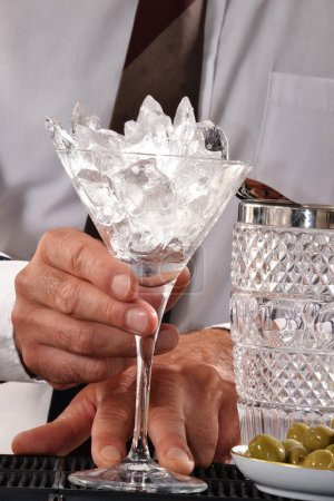 Photo for Bar man holding ice cube cocktail glass. Bartender preparing alcoholic cocktails. - Royalty Free Image