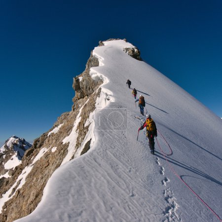 Photo for Team of climbers summiting a mountain - Royalty Free Image