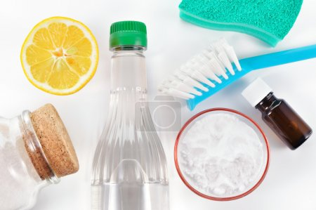 Photo for Eco-friendly natural cleaners. Vinegar, baking soda, salt, lemon and essential oil. Homemade green cleaning on white background. - Royalty Free Image