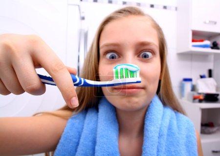 Blonde girl is surprised when brushing your teeth