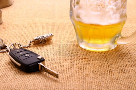 Car key with accident and beer mug