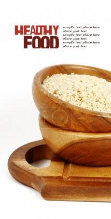 uncooked rice in wooden plate