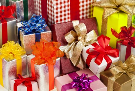 Many colorful gift boxes with ribbon bows